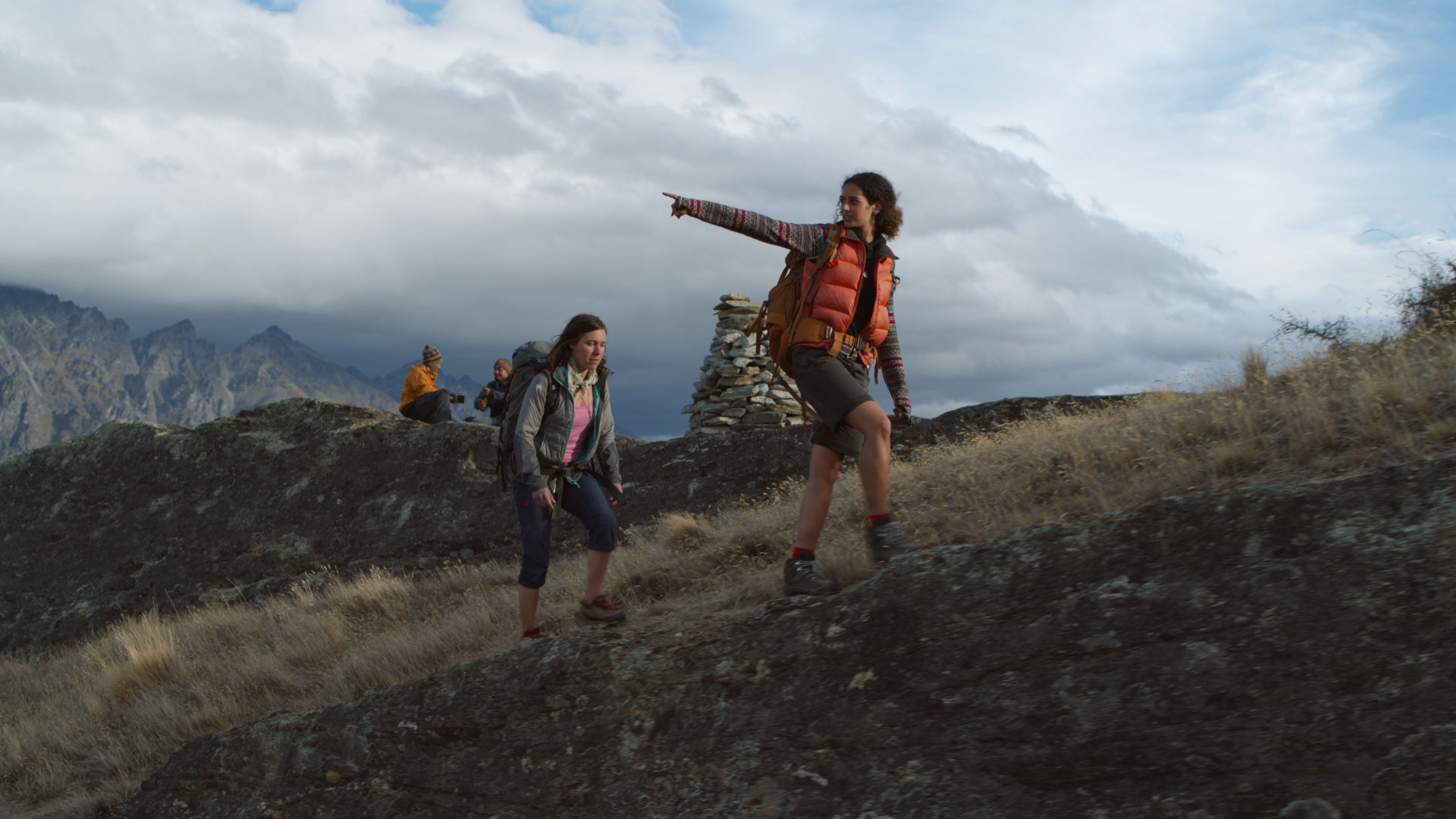 outdoor sky hiking grass person clothing cloud footwear mountain nature woman