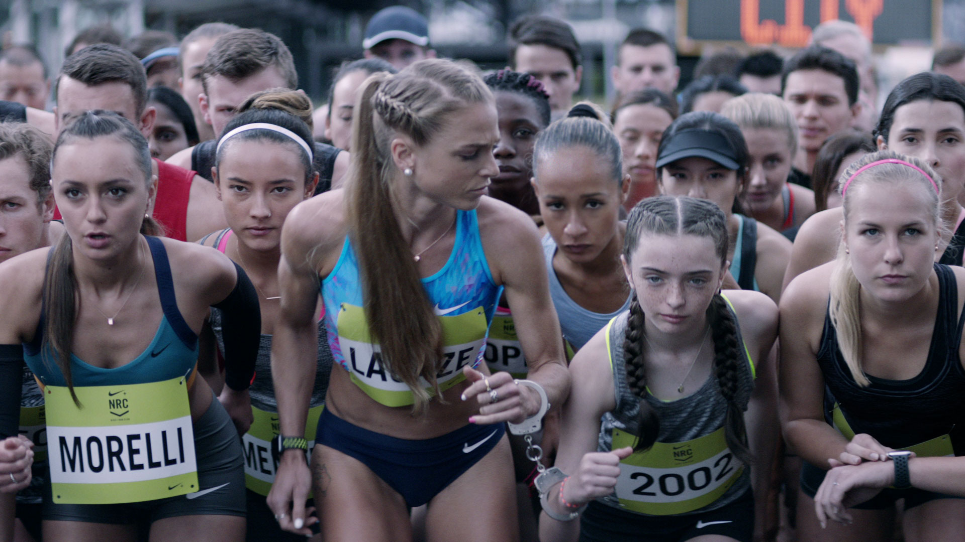 person outdoor human face clothing woman people group track and field athlete sports uniform crowd