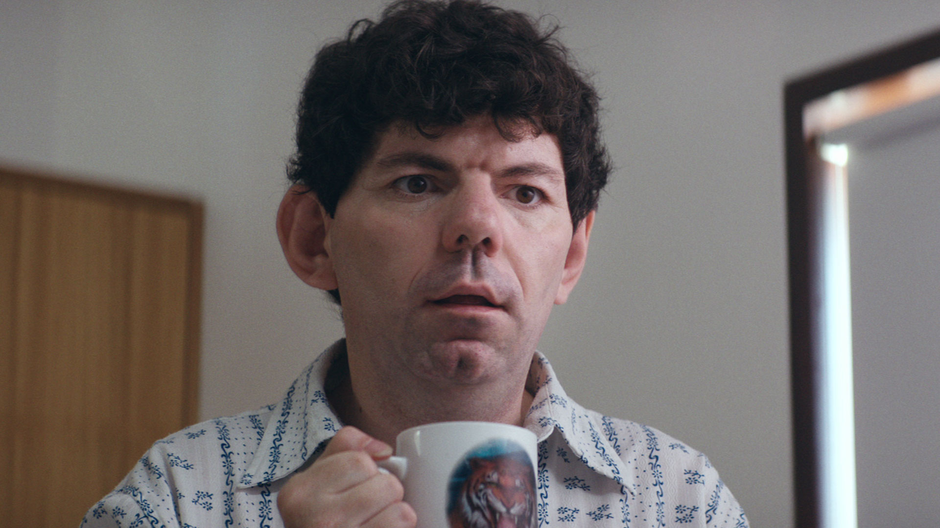 A Man holding a cup