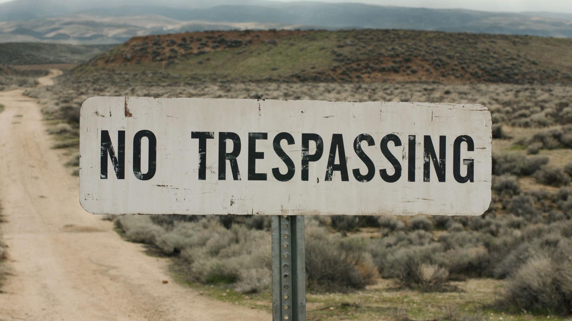 text outdoor sign grass mountain sky billboard desert handwriting traffic sign dirt
